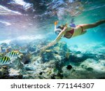 girl snorkeling in a beautiful... | Shutterstock . vector #771144307