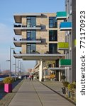 Small photo of Bremen, Germany - November 25th, 2017 - Modern residential building above the esplanade at the Europa harbor in the Überseestadt district with all-round balconies