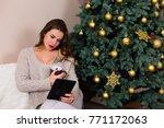 beautiful young woman reading e ...   Shutterstock . vector #771172063