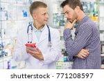 professional male pharmacist... | Shutterstock . vector #771208597
