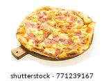hawaiian pizza on wooden tray... | Shutterstock . vector #771239167
