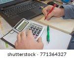 businessman using a calculator... | Shutterstock . vector #771364327