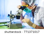 woman in a laboratory working... | Shutterstock . vector #771371017