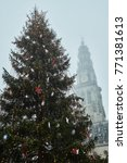 Small photo of Christmas tree and steeple in the fog of Arras, France