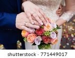 bride and groom hands with... | Shutterstock . vector #771449017