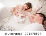 tired and sleepy parents  | Shutterstock . vector #771475537