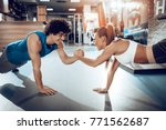 young muscular couple doing... | Shutterstock . vector #771562687