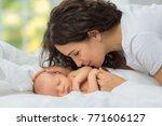 mom's love newborn. | Shutterstock . vector #771606127