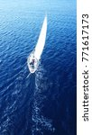 Small photo of Aerial drone birds eye view of sail boat cruising in the Aegean, Greece