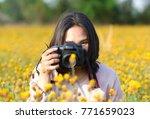 asian female hand holding... | Shutterstock . vector #771659023