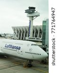 Small photo of FRANKFURT, GERMANY - MAY 8, 2017: Lufthansa Boeing 747 and Air Traffic Control Tower at Frankfurt Airport in Germany