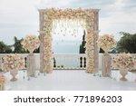 elegant wedding arch with fresh ...