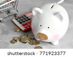 piggy bank with calculator and... | Shutterstock . vector #771923377
