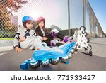 happy inline skaters sitting on ... | Shutterstock . vector #771933427