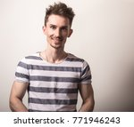 handsome young man in striped... | Shutterstock . vector #771946243