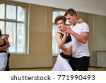beautiful couple dancing tango | Shutterstock . vector #771990493
