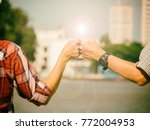 two engineer bump together.... | Shutterstock . vector #772004953