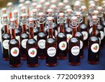 identical bottles with a drink... | Shutterstock . vector #772009393