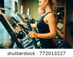 young woman exercising on cross ... | Shutterstock . vector #772013227