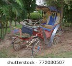 Old Carriage In An Abandoned...