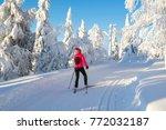 woman cross country skiing | Shutterstock . vector #772032187