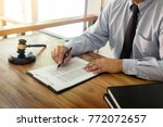lawyer hand writes the document ... | Shutterstock . vector #772072657