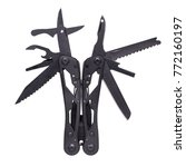 Small photo of Black multi tool photographed on a white background. The multitool is with all of its instruments: scissors, a saw blade, a screwdriver attachment, an opener, a knife and others