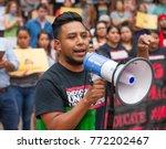 an activist wearing a t shirt... | Shutterstock . vector #772202467