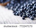 blueberries on white table.... | Shutterstock . vector #772247173