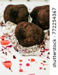 Small photo of Baked beets for a Christmas soup on a white background. Holiday food. Baking with aluminium foil