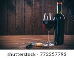 bottle and glass of red wine ... | Shutterstock . vector #772257793