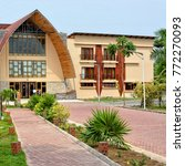 Small photo of Building of the Aqua Safari Resort. Main avenue. Relax at a luxury beach resort. Travel and vacation in West Africa. Ghana, Volta, Ada - January 14, 2017