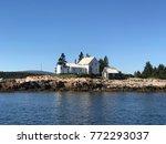winter harbor lighthouse  mark... | Shutterstock . vector #772293037