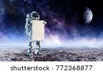 spaceman with banner. mixed... | Shutterstock . vector #772368877