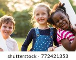 kids having a fun time together | Shutterstock . vector #772421353