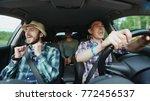 group of happy friends in car... | Shutterstock . vector #772456537