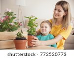 cute little girl with mother... | Shutterstock . vector #772520773