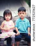 Small photo of family and love concept / Brother and sister looking forward / Closeup Asian brothers sitting on the bench / composing with vintage tone.