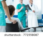 professional doctors examining... | Shutterstock . vector #772558087