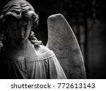 a sad winged angel at an old... | Shutterstock . vector #772613143