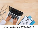 doctor working at desk table... | Shutterstock . vector #772614613