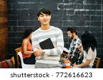 asian young man with tablet... | Shutterstock . vector #772616623