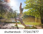 Young Woman Doing Yoga In...