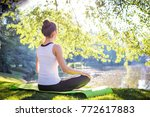young woman doing yoga in... | Shutterstock . vector #772617883