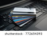 credit cards on a laptop... | Shutterstock . vector #772654393