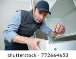 workman fixing kitchen drawer...   Shutterstock . vector #772664653