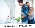 young happy couple is washing... | Shutterstock . vector #772667137