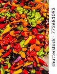 mixed peppers hanging being sun ... | Shutterstock . vector #772681093