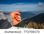 Man's Hand Shows Magic Winter...