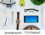 high angle shot of items on a... | Shutterstock . vector #772704547